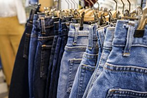 Row of hanged blue jeans skirts