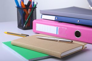 Folder file, note and pen on the