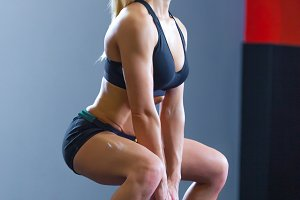 Fit woman doing squats with