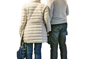Couple Holding Hands Back View