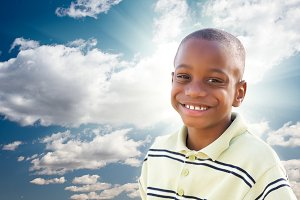 Young African American Boy with Clou