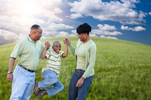 Family Over Clouds, Sky and Grass Fi