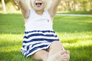 Cute Little Girl with Thumbs Up in t