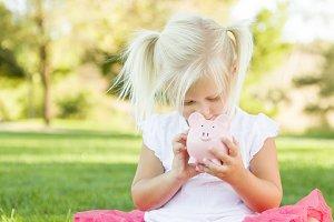 Little Girl Having Fun with Her Pigg