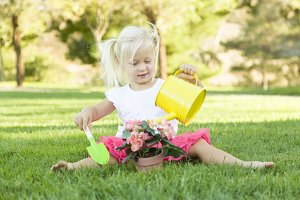 Cute Little Girl Playing Gardener wi