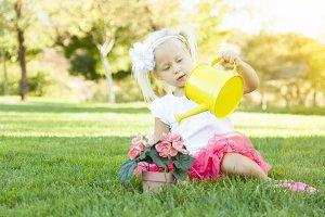 Cute Little Girl Playing Gardener