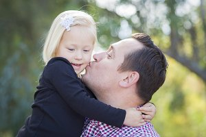 Father Kissing Adorable Little Girl