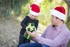 Father Giving Young Daughter Christm