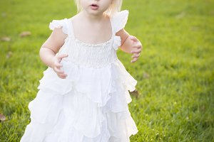 Adorable Little Girl Wearing White D