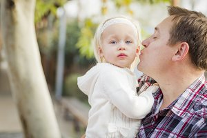 Adorable Little Girl with Her Daddy