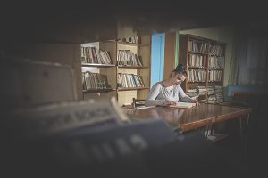 Young women in a vintage library
