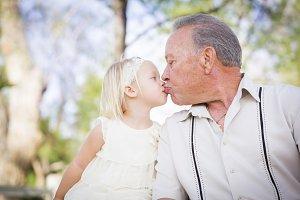 Grandfather and Granddaughter Kissin