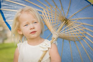 Cute Baby Girl Holding Parasol Outsi