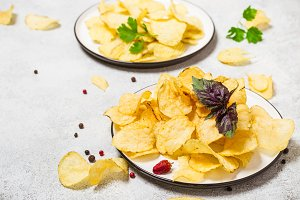 Crispy potato chips on a plate close
