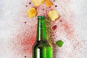 Beer bottle and crispy potato chips