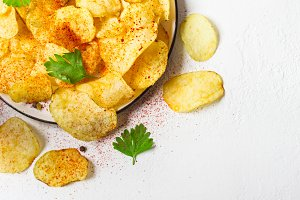 Crispy potato chips on a plate on a