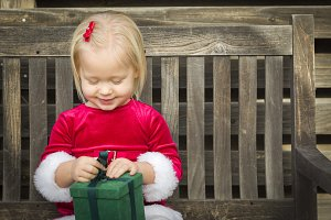 Adorable Little Girl Unwrapping Her