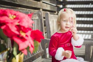 Adorable Little Girl Sitting On Benc