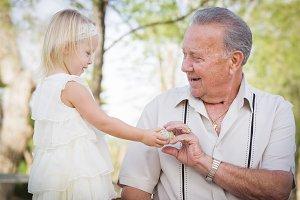 Cute Baby Girl Handing Easter Egg to