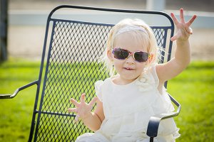 Cute Playful Baby Girl Wearing Sungl