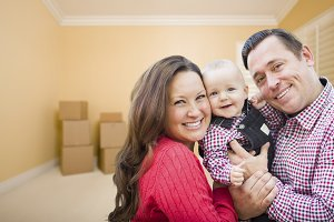 Young Family In Room With Moving Box