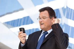 Businessman Looking at Cell Phone Cl