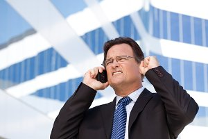 Excited Businessman on Cell Phone