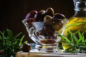 Black and green Greek olives in glas