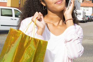 woman with cell phone and bag
