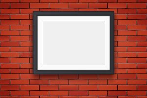 Red brick wall with picture frame