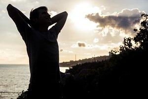 relaxing man silhouette standing nea