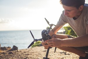 close up person adjusting the drone