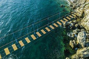 aerial view of rope bridge between t