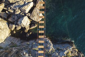 aerial view of rope bridge between t