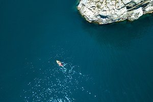 aerial view of kayak boat going near