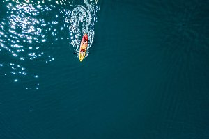 two men in kayak boat aerial isolate