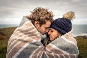 Young couple embracing outdoors unde