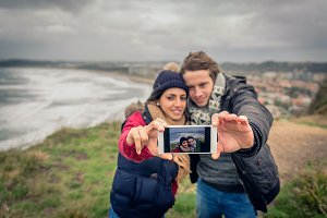 Young couple taking selfie photo wit
