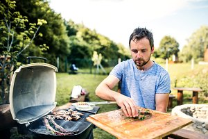 Mature man cooking seafood on a