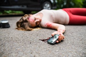 Young injured woman with smartphone