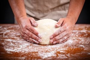 Baker hands making sourdough bread