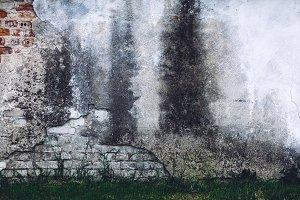 Old grunge damaged wall of an old bu