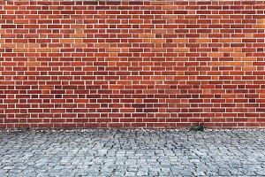 Retro red brick wall and cobblestone