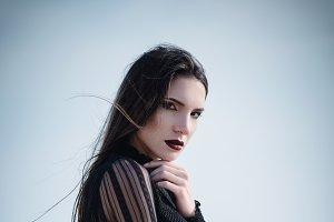 Beautiful sad girl in black dress