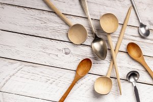 Set of spoons on white wooden table