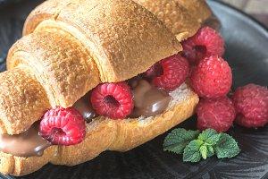 Croissant with raspberries
