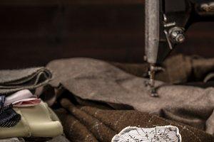 Vintage sewing set on old wooden tab