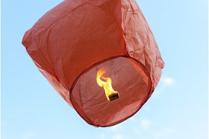red paper lantern, flying in the sky