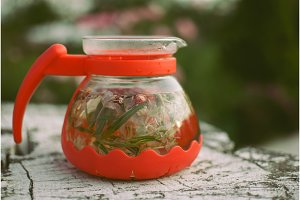teapot of fruit tea with herbs and