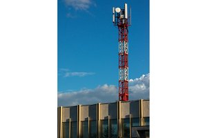 Red and white antenna tower on the